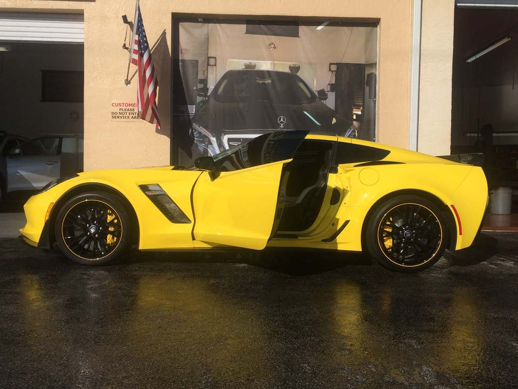Yellow corvette getting windows tinted in Fort Myers, FL