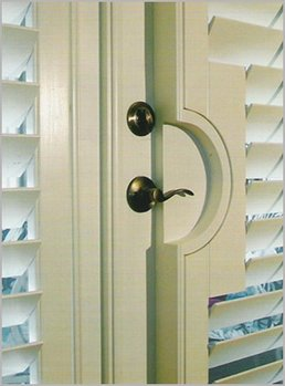 Plantation Shutters Installed Around Doorknob Of French Doors