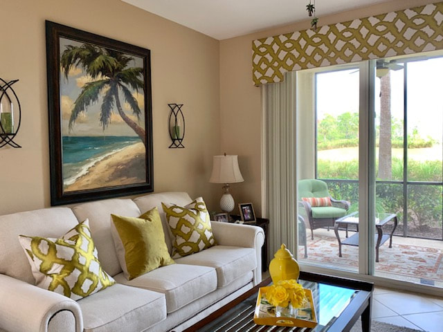 Matching cornice, pillows, and draperies at home in Orangetree, FL