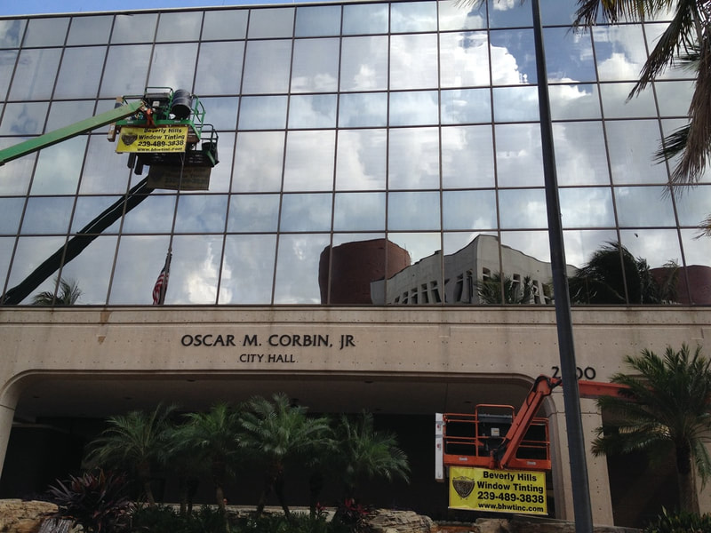 Installing exterior security film at Fort Myers City Hall