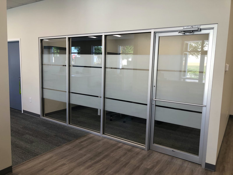 Privacy window film installed in conference room at Quality Cabinets and Counters in Fort Myers