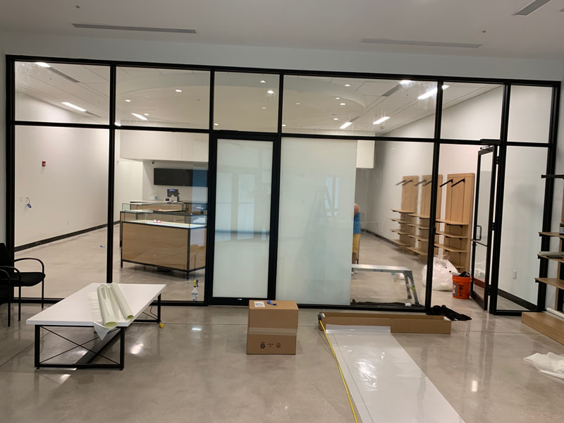 Adding privacy window film between waiting room and product room at Grow Healthy in Bonita Springs, FL