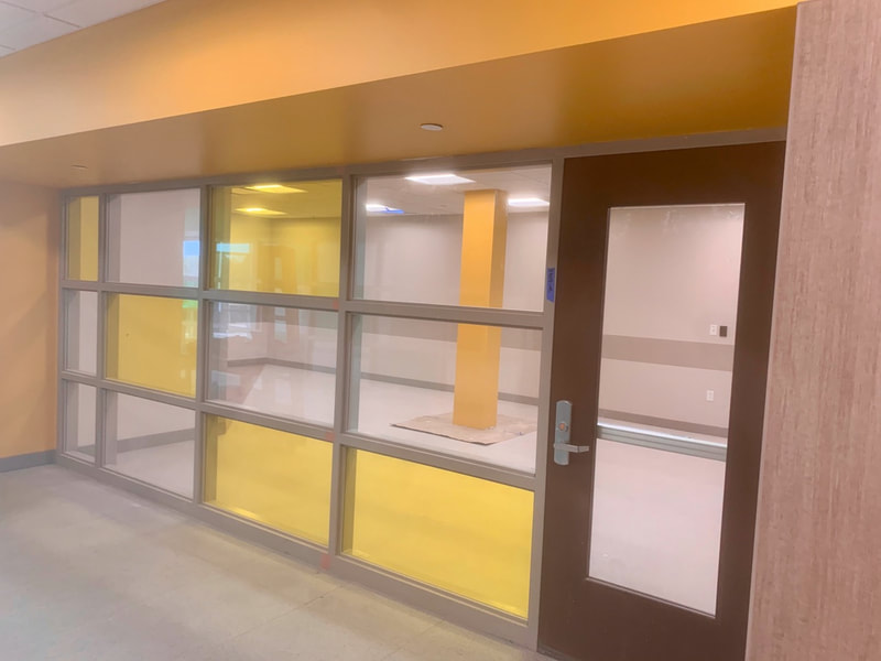 Nichols Community Health Center. Office with yellow film.
