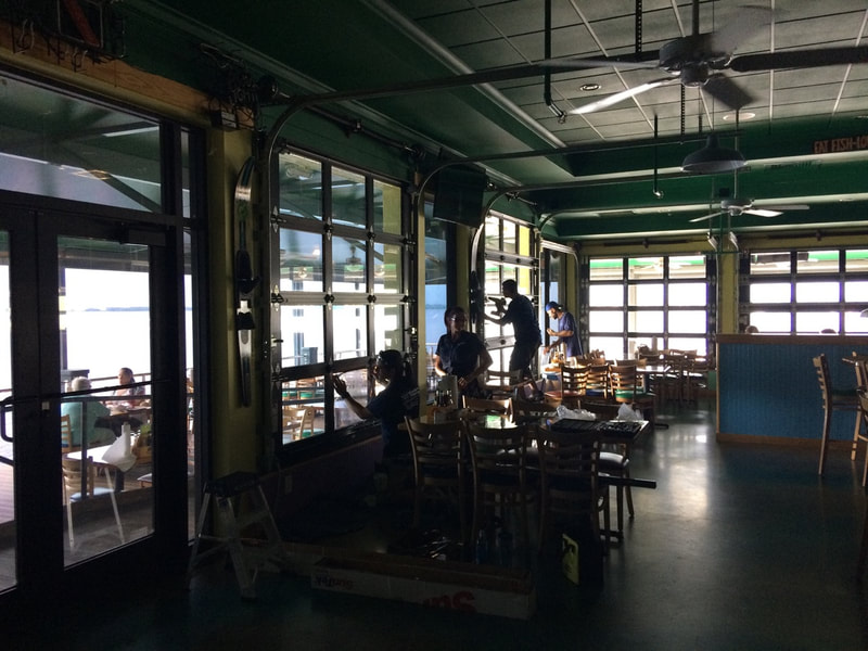 Beverly Hills Window Tinting installers working inside Pinchers Crab Shack. Fort Myers