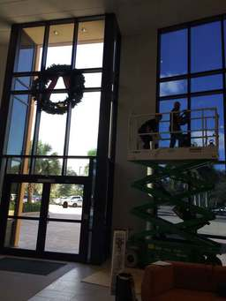 Technician installs window tint films at Gartner Inc. in Fort Myers, FL